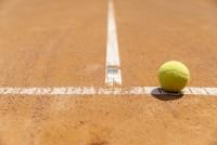 close-up-tennis-ball-on-court-ground
