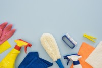 top-view-cleaning-supplies-with-copy-space